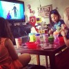 three young girls watching a TV show