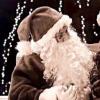 A little girl sitting on Santa's lap