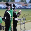students perform in band on sidelines of football game