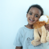 boy holding lion stuffed animal