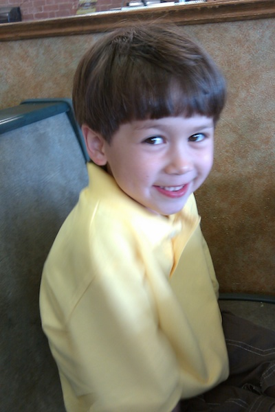 The author's son wearing a yellow shirt