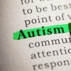 A highlighter pressed against a page and highling the word 'Autism'