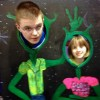 boy and girl posing in colorful cut out