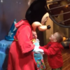 young boy meeting mickey mouse at disneyland