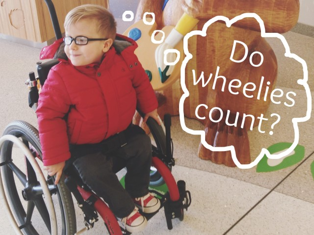 "A photo of the author's son in a wheelchair with the thought bubble, ""Do wheelies count?"""