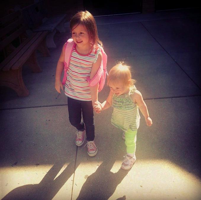 Ali Schmeder-Cummins older sister and younger sister walking
