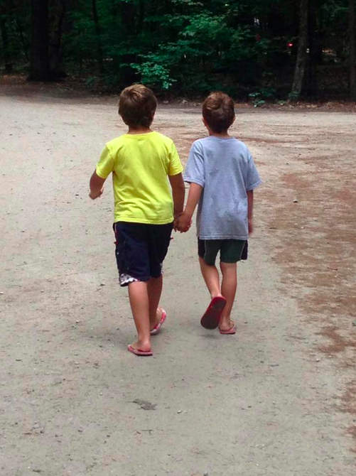 Jennifer Joy Brooking brothers hand in hand walking through park