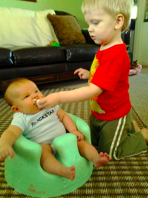 Jodie Tompkins, big baby brother feeding younger brother