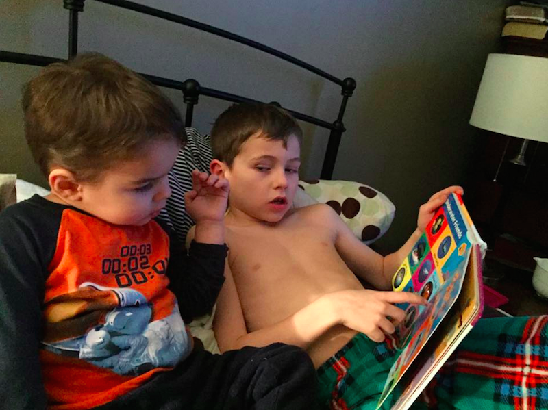 Leslie Ann two brothers, one reading to the other