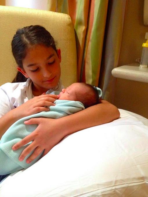 Ruth Radack Tsikouris older sister holding baby sibling