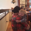 mom hugs her young son at home