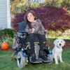 A woman in her wheelchair with her dog