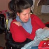 A girl with special needs opening a gift