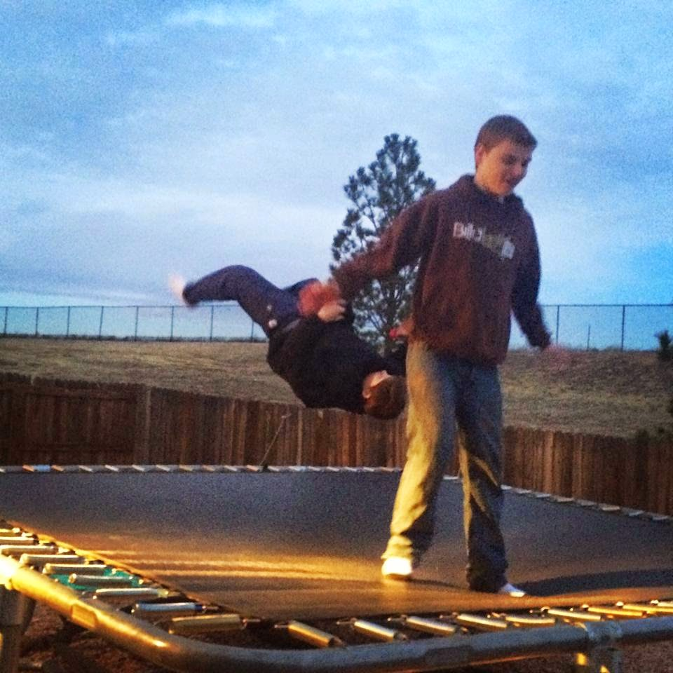 friends playing on the trampoline