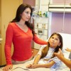 Mother And Daughter Talking To Consultant In Hospital Room