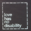 "sign saying ""Love Has No Disability"""