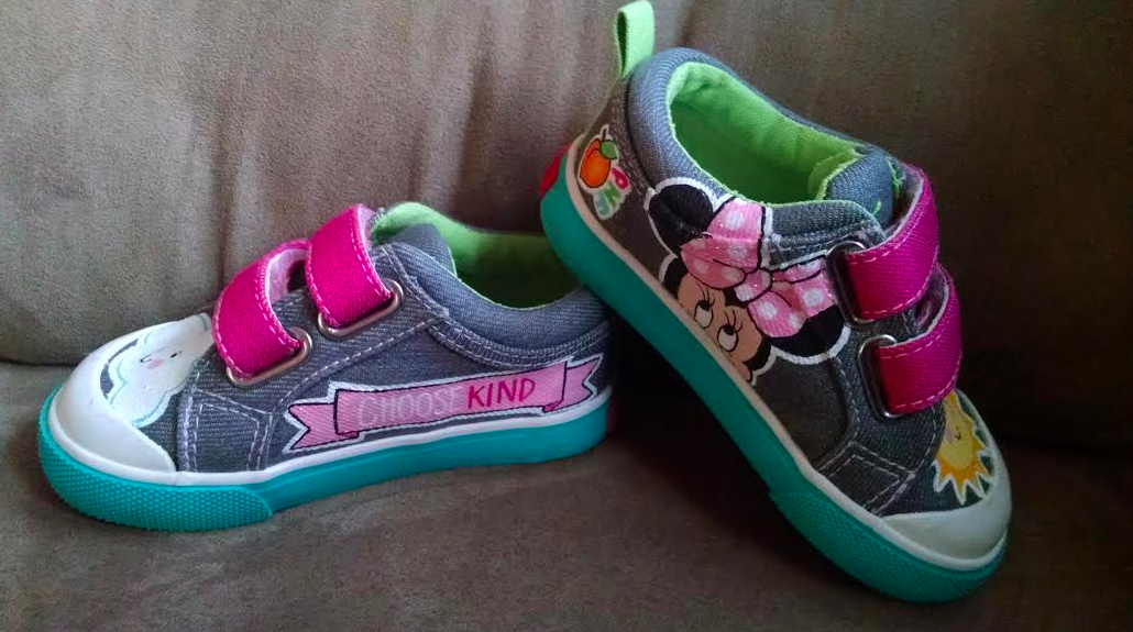 shoes given to Beth's daughter from Peach's Neet Feet. one shoe has a picture of minnie mouse and the other shoe has a pink banner that says 'choose kind'