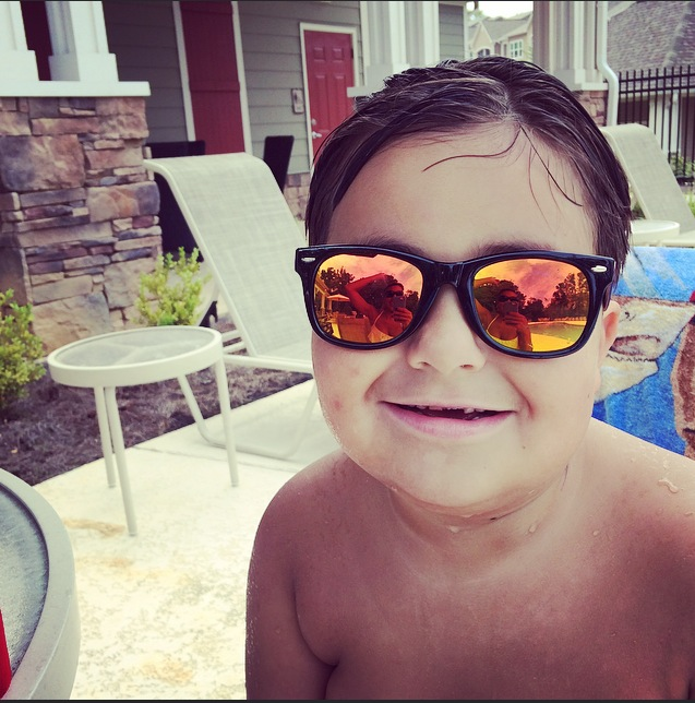 son wearing sunglasses