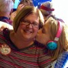 daughter kisses mother on the cheek