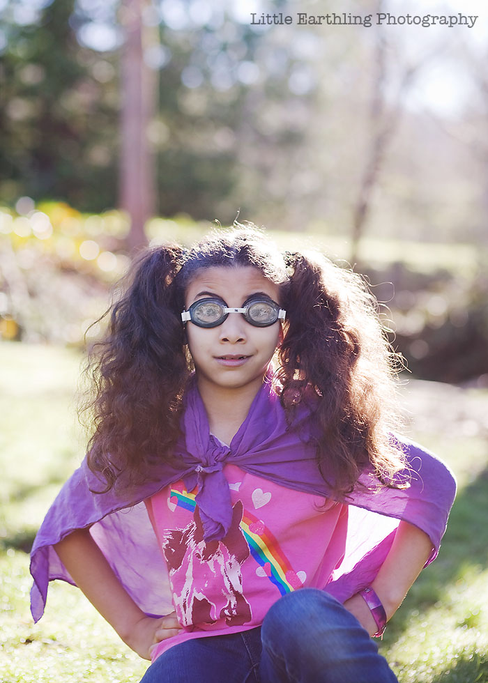 Avi wearing goggles and a purple cape