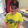 young boy wearing a San Francisco Giants cap