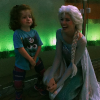 young girl with elsa from frozen at disneyland