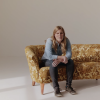 blind woman sitting on a couch and talking about what beauty means to her