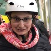 A young woman with glasses in a helmet