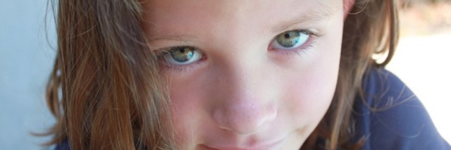 adolescent girl looks into camera close-up