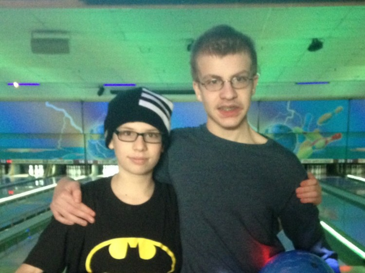 two boys at a bowling alley