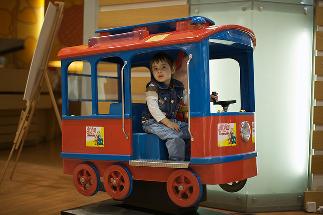 little boy in mall train