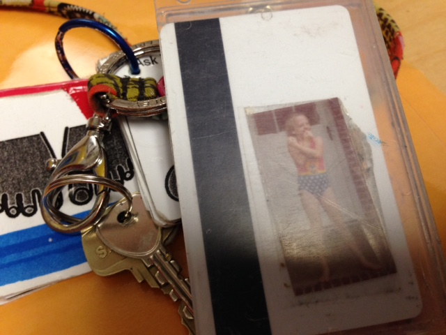 teacher's keychain with photo of her as a kid dressed as wonder woman
