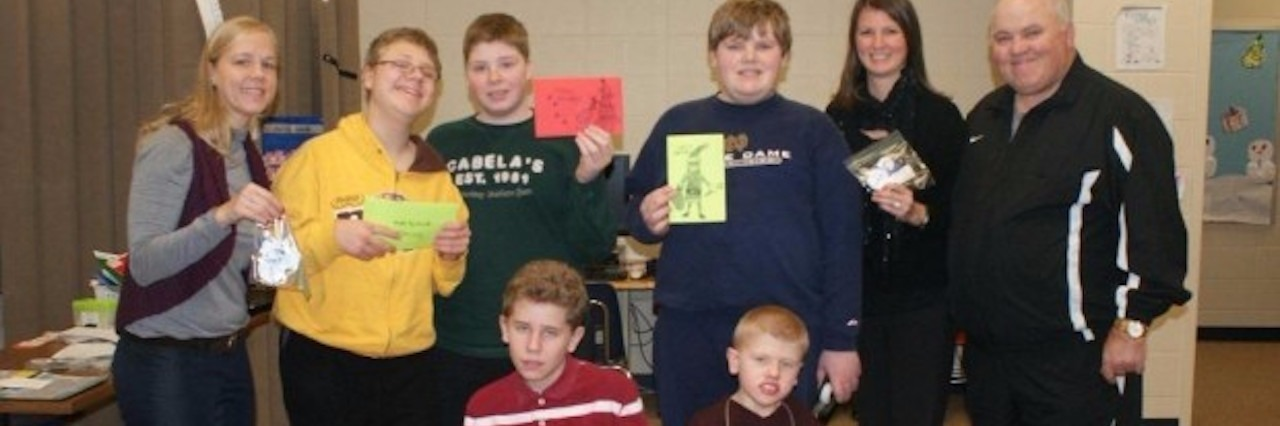 group of special needs students smiling at school