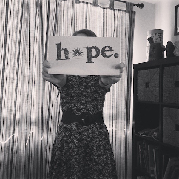 woman holding hope sign