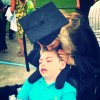 mom kissing son in wheelchair
