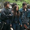 "An image from the show ""The 100"" with two guys and a woman standing next to each other looking outward"