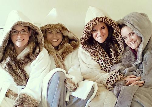 four women in warm jackets