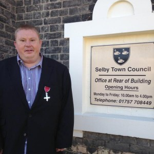 mayor gavin harding stands in front of town council building
