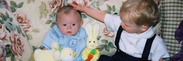 author's son sitting on the couch during easter with his brother