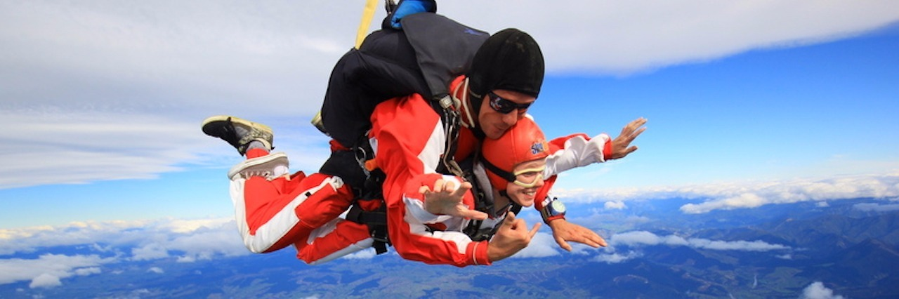 woman skydiving above new zealand