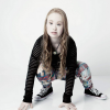 Madeline Stuart crouched over with her hands on the floor