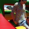 mom with her son on a bounce house