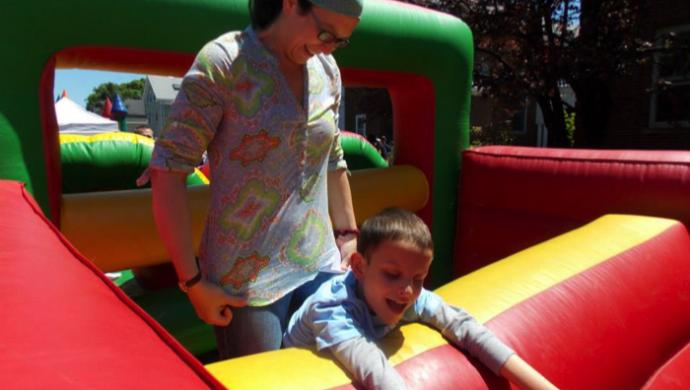 mom and son in bouncy house