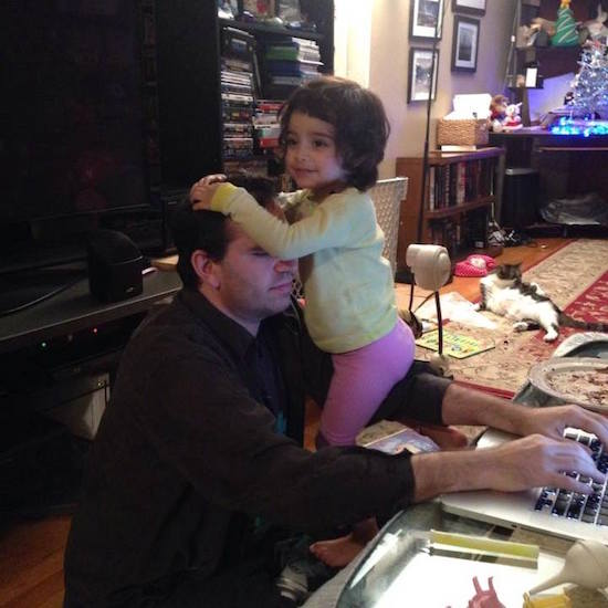 dad with daughter working on computer