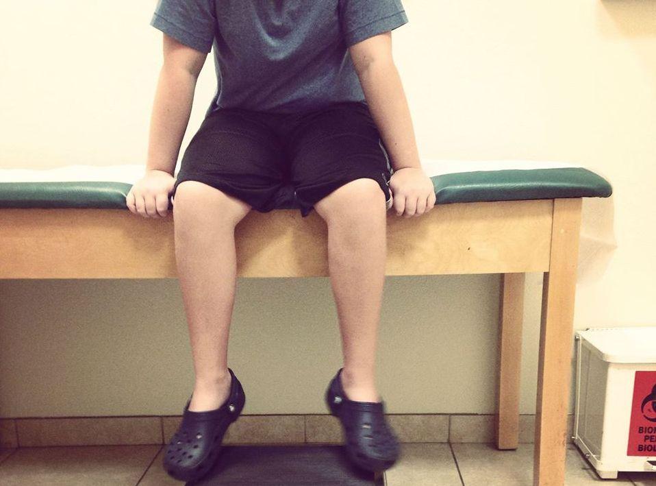 boy sitting in doctor office