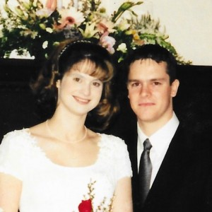wedding photo of husband and wife with cap sleeve gown