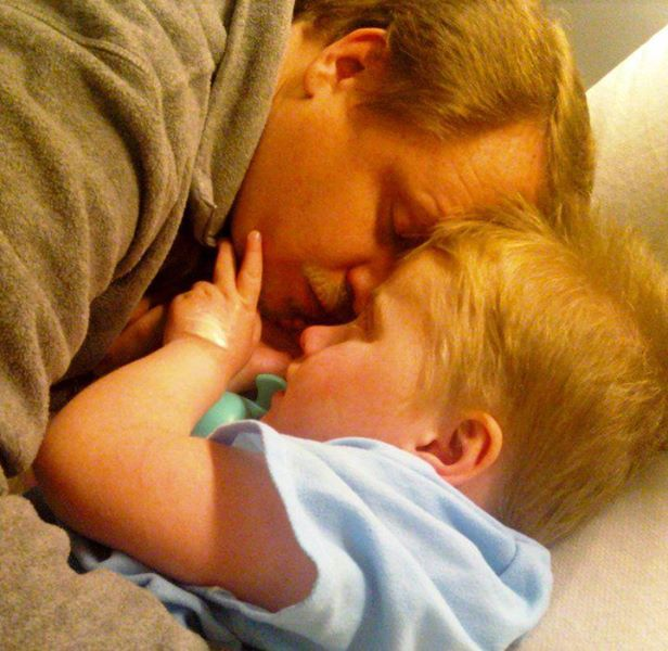 Dad touching foreheads with child in the hospital