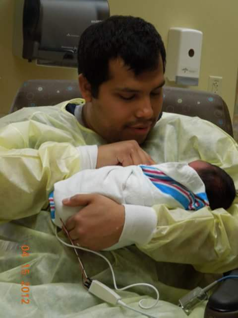 Dad holding baby in the hospital
