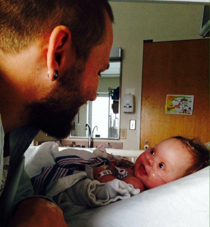 Dad smiling at baby in hospital