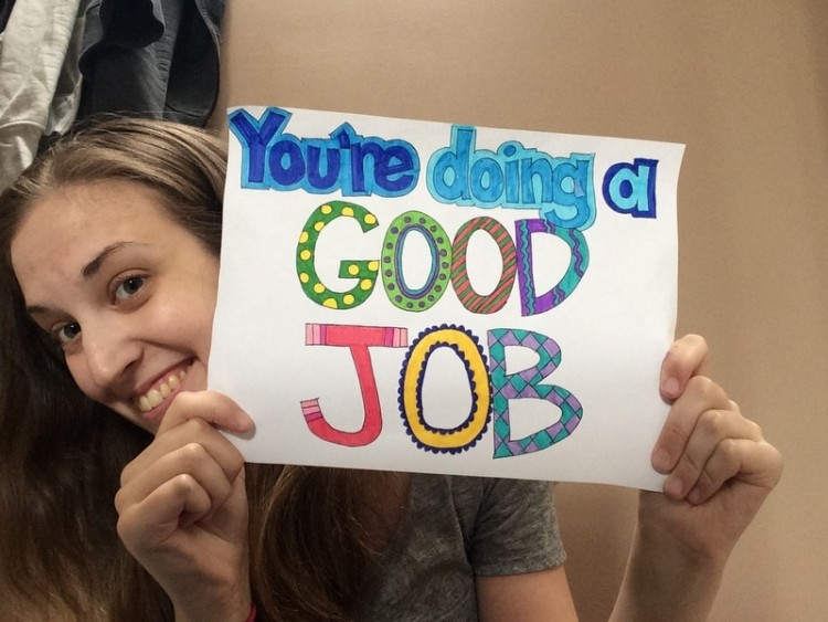 Catherine Richardson holding sign that says you're doing a good job